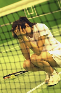 Unhappy woman playing tennis