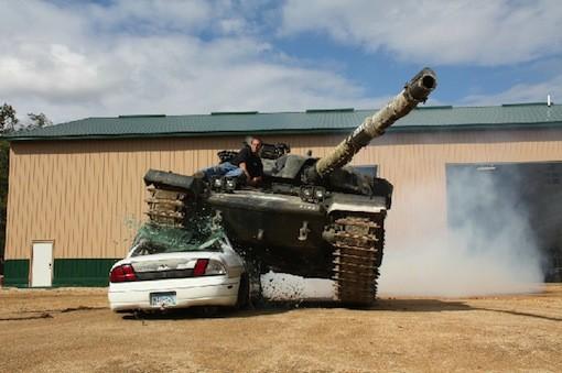 A tank crushing a car