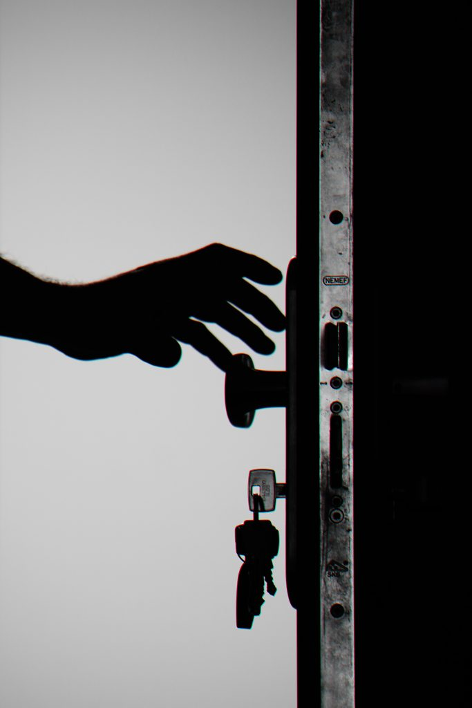 silhouette photo of person holding door knob 792032