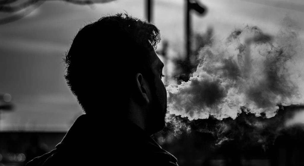 grayscale photography of man smoking 849203