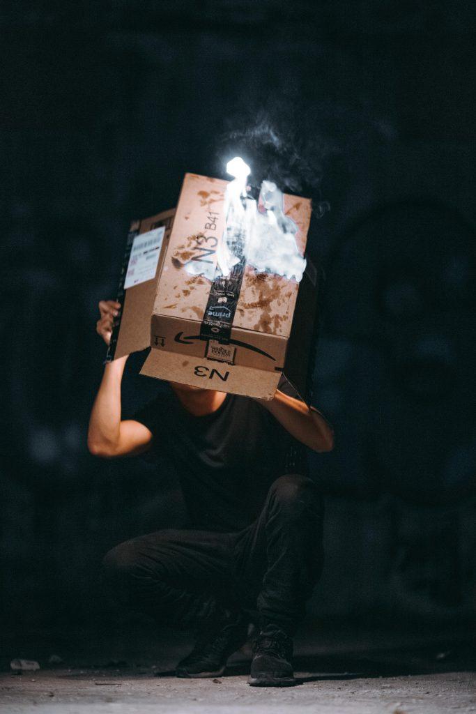 man raising cardboard box 2257704